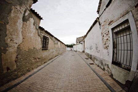 rural town: Street with houses made of mud, rural town Stock Photo