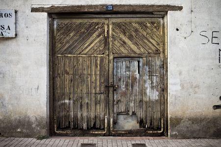 Old door in old street of shops photo
