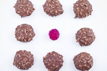 fatten: Chocolate candy over white background.