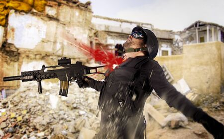 Assault troops, soldier wounded in action, shot in the chest Stock Photo - 8428024