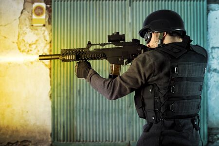 hellfire: Street Assault, riot police firing his submachine gun Stock Photo