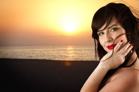 Young beautiful girl posing on beach in sunset Stock Photo - 10089613