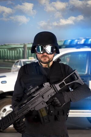 Armed man in protective cask with machine gun. Police Stock Photo - 10089609