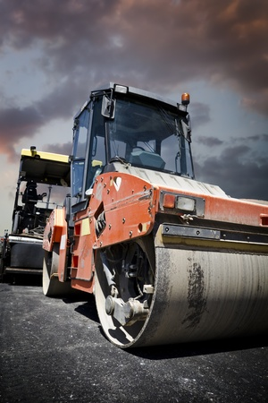 roller compactor: Heavy Vibration roller at asphalt pavement works (road repairing) Stock Photo