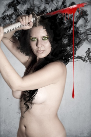 beautiful brunette warrior holding a katana sword with her hair floating in the background and blood dripping from her sword photo