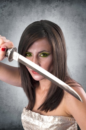 beautiful female warrior holding katana sword ready for the attack photo