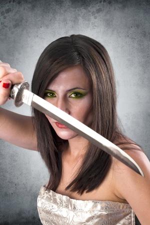 beautiful female warrior holding katana sword ready for the attack photo