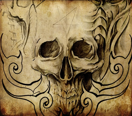 Tattoo art, sketch of skull with tribal designs photo