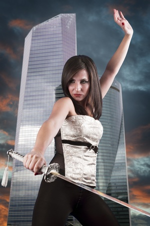 Beautiful girl in a business center with a katana. Angry photo