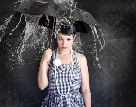 Beautiful gil with umbrella in a depressed state, emotions. Stock Photo - 12005202