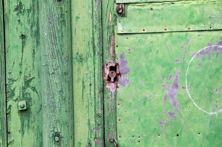Green wooden panels. Ancient door photo