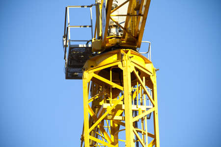 yellow crane, blue sky photo