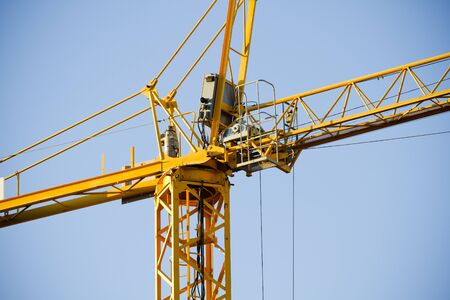 Yellow Crane against Blue Sky photo