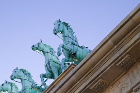 Brass horses over neoclassical ceiling photo