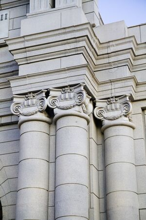 Classical style columns in ionic order on exterior of modern building. photo