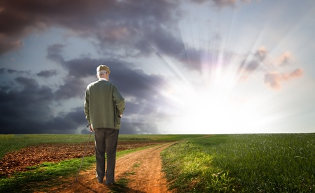 robust: old man walking his path searching for the light