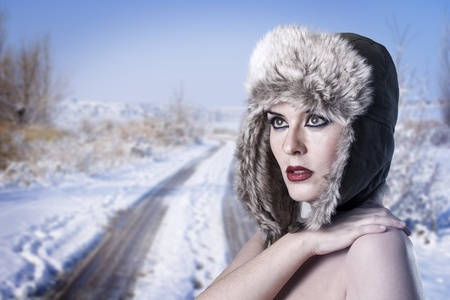 cold winter woman over snowed desolated background photo