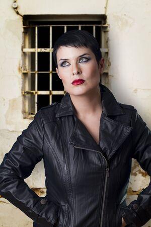 hard rock beautiful woman with window background Stock Photo - 12597767