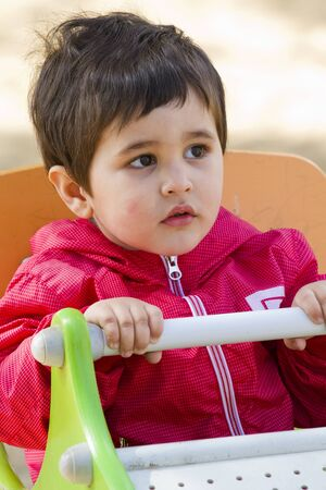 Cute little baby boy playing at park , smile photo