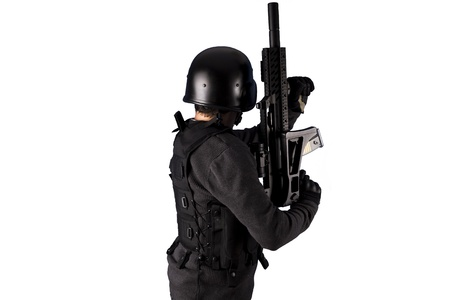 police helmet: Armed man in protective cask with a pistol. Isolated on white. Stock Photo