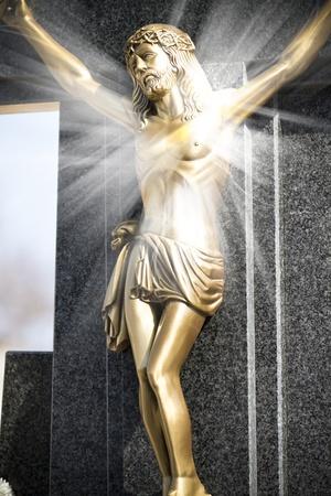 Jesus Christ on stone cross with mystic rays of light Stock Photo - 13028681