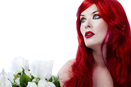 A beautiful fiery red haired woman with white rose. Spring concept photo