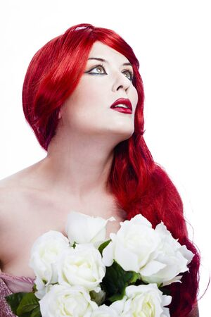 Attractive redhead woman, long red wavy hair with beautiful white roses photo