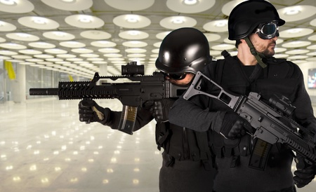 Police against terrorism, two soldiers at an airport Stock Photo - 13200549