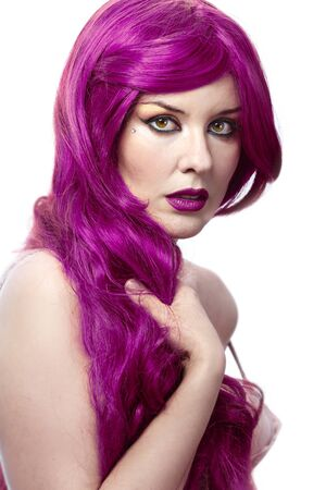 Beautiful sexy woman with magnificent purple hair over white background photo