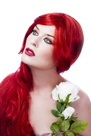 Beautiful red haired with fresh flowers in her hand. Spring concept. photo