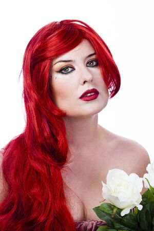Beautiful red haired with Spring Flowers. Fresh skin concept photo