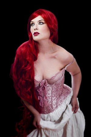Red haired woman in lingerie over black background Stock Photo - 13344491