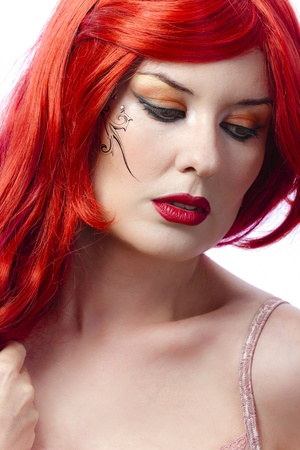 Red haired tattooed woman over white background photo
