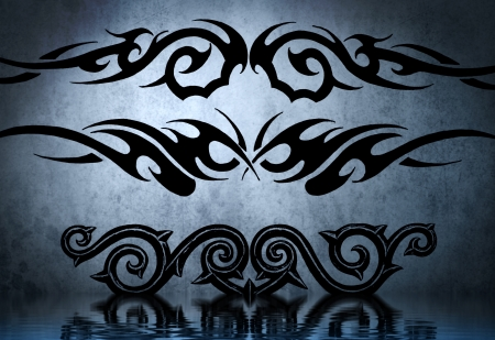 Black tribal armband with water reflection. Tattoo design over blue wall photo