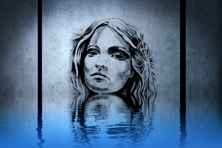 Indian womans head on blue wall reflections in the water photo