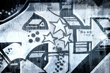 Graffiti over old dirty wall, urban hip hop background Gray texture painted with bright colorful Stock Photo - 13386927