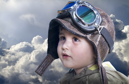 A little cute baby dreams of becoming a pilot. Pilot outfit, hat and glasses photo