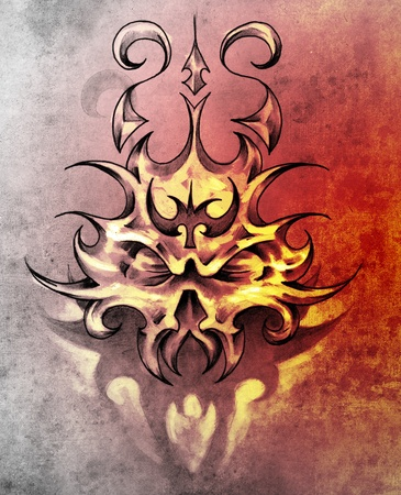 Sketch of tattoo art, skull mask with tribal design photo