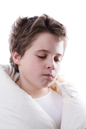 blond child sick with fever, digital thermometer and white blanket photo