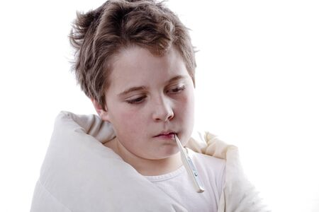 Young boy patient with fever, with digital thermometer and white blanketand flu photo