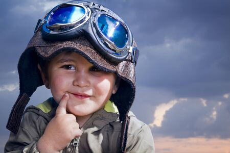 Adorable baby dressed in pilot uniform with funny face photo