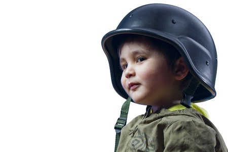Baby playing war with military helmet photo