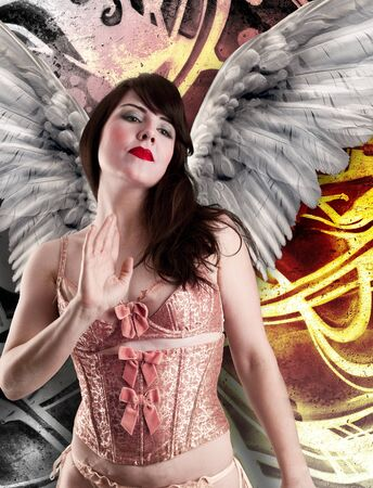 Sweet woman angel in lingerie, over graffiti background. Stock Photo - 13601624