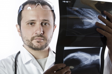 Doctor holding an x-ray appeal of a hand photo