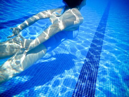 Girl swimming underwater in a swimming pool Stock Photo - 14507047