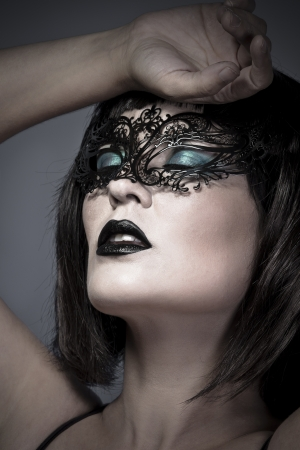 Sensual woman with delicate Venetian mask photo
