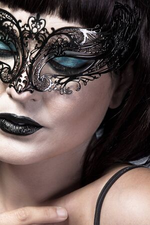 Detail of face of beautiful and sexy woman with delicate Venetian mask photo