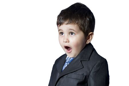 Surprised businessman child in suit with funny face photo