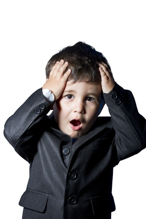Surprised businessman child in suit photo