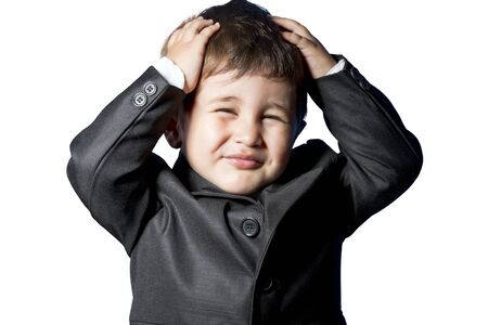 Child dressed businessman with funny face photo